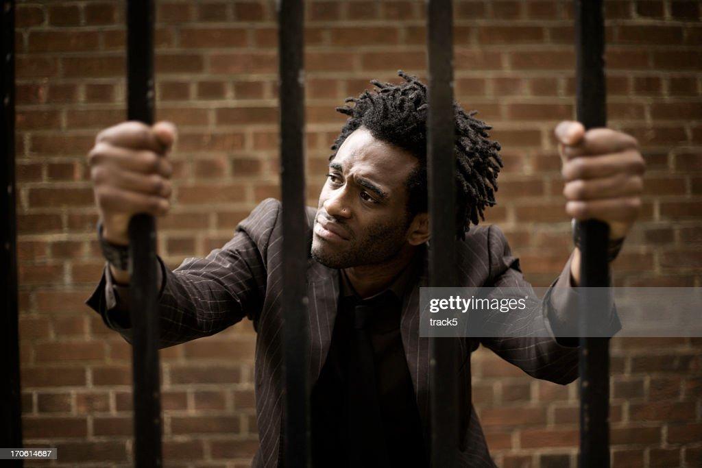 behind bars : Stock Photo
