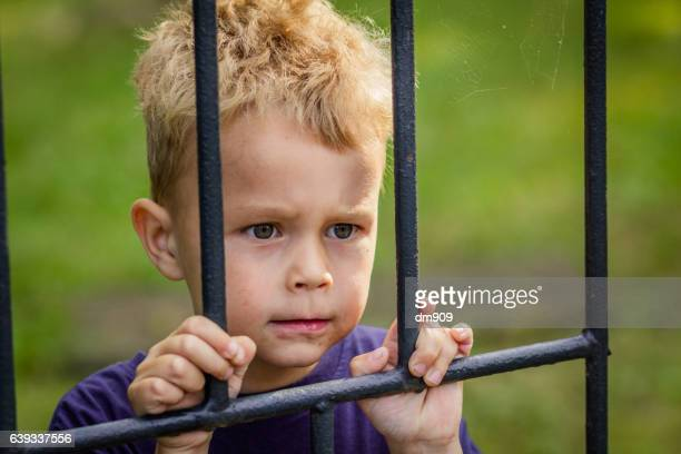 behind bars - child behind bars stock pictures, royalty-free photos & images