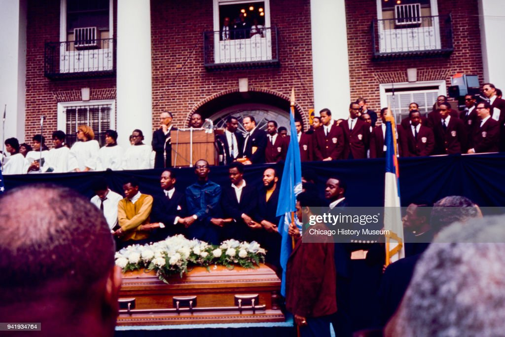 Behind Dr Martin Luther King Jr's casket, mourners link hands as Reverend Ralph Abernathy (1926 - 1990) speaks during Dr King's public memorial service at Morehouse College, Atlanta, Georgia, April 9, 1968.
