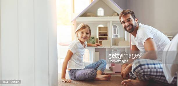 behind every great kid is a great dad - dollhouse stock pictures, royalty-free photos & images