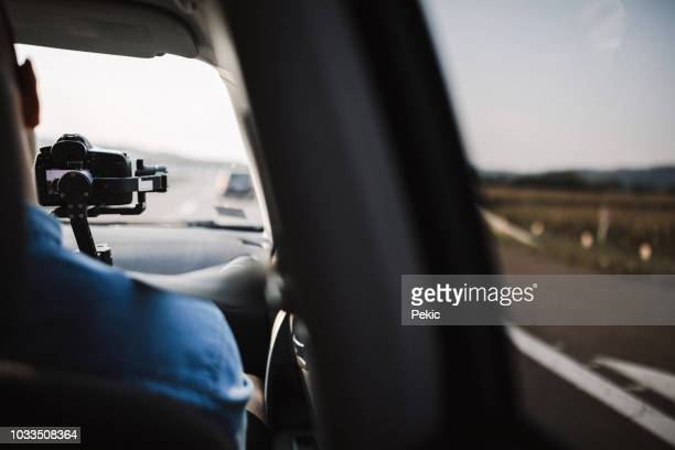 behind scene improvisation - cameraman filming  from car - following moving activity stock pictures, royalty-free photos & images