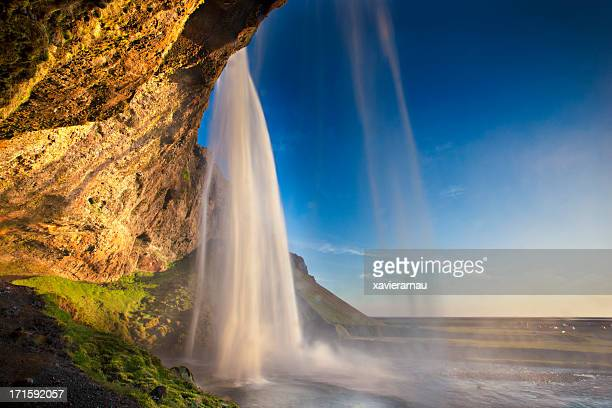 behind seljalandsfoss waterfall - behind waterfall stock pictures, royalty-free photos & images