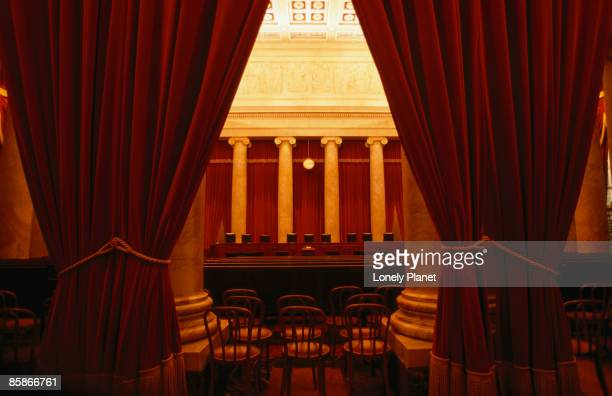 Behind the curtain is the Supreme Court of Washington DC.