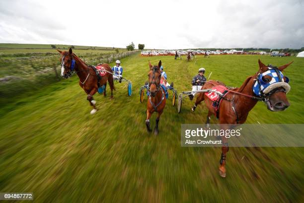 Behind the pacer car at the start at Pikehall harness racing course on June 11 2017 in Matlock England