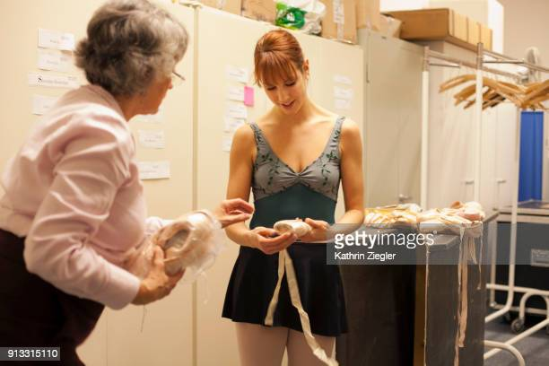 Behind the scenes at the Bavarian State Ballet: Dancer at pointe shoe department choosing shoes