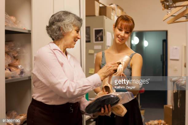 Behind the scenes at the Bavarian State Ballet: Dancer at pointe shoe department getting new shoes