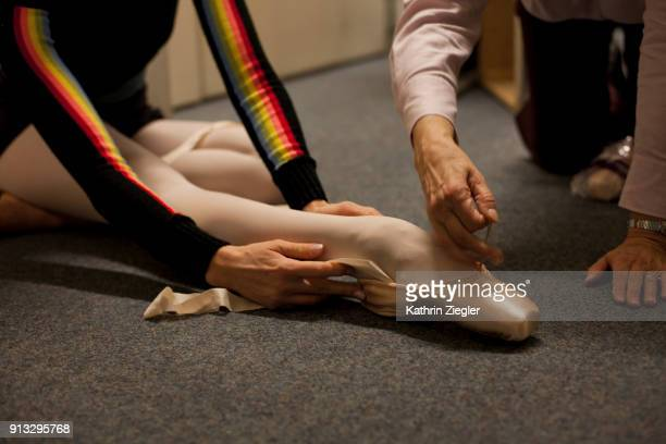 behind the scenes at the bavarian state ballet: dancer trying on pointe shoes - stockings feet stock pictures, royalty-free photos & images