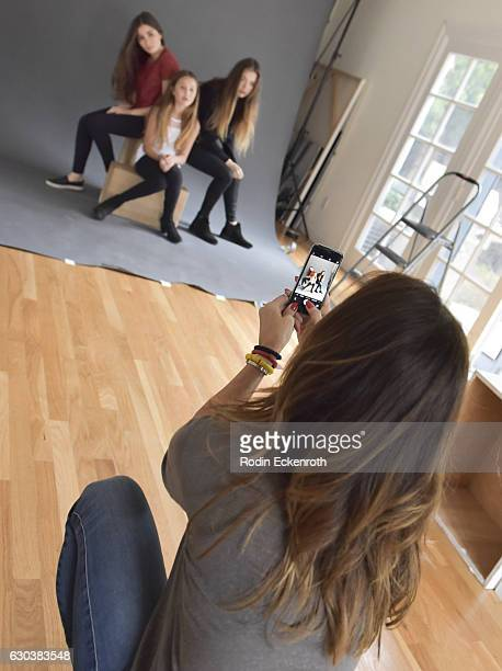 Behind the scenes with actress/model Brooke Burke and her daughters Heaven Rain Charvet Sierra Sky Fisher and Neriah Fisher at The Artists Project on...