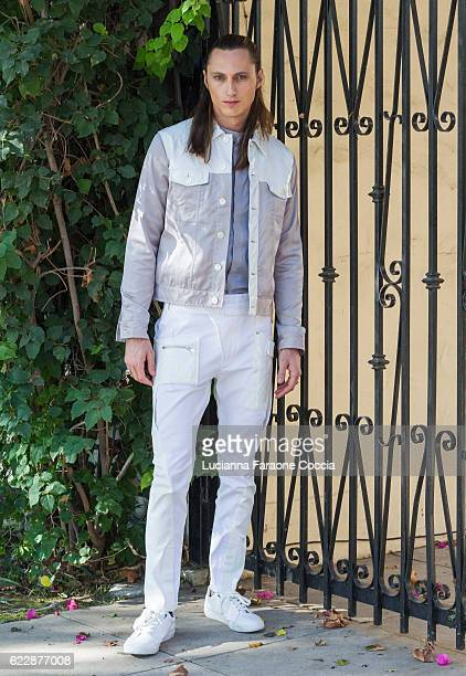 Behind the scenes with model Aaron Mann at 'Front Row' fashion shoot at The Starving Artists Project on November 12 2016 in Los Angeles California