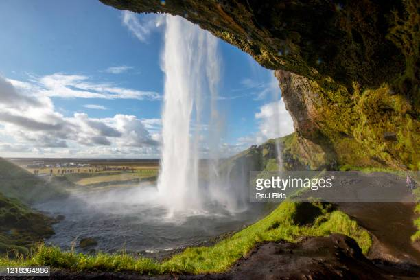 behind the waterfall - seljalandsfoss waterfall in iceland - behind waterfall stock pictures, royalty-free photos & images