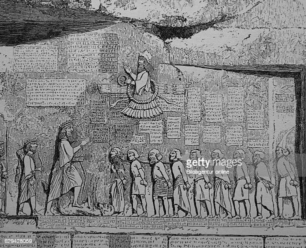 Behistun inscription relief with an inscription about darius i bistun in kermanshah iran woodcut from 1880