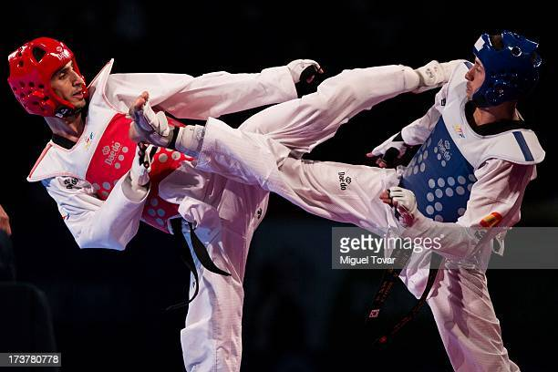 Behnam Asbaghikha of Iran competes with Jose Antonio Rosillo of Spain during a Men's 68 kg combat of WTF World Taekwondo Championships 2013 at the...