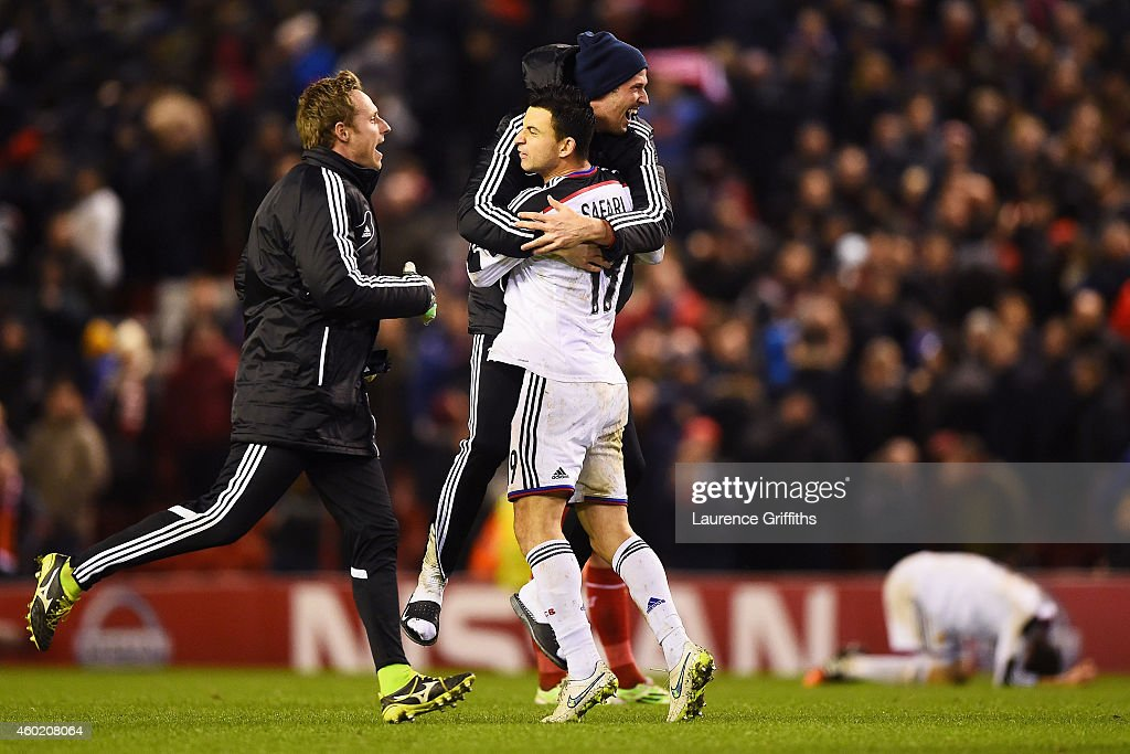 Behrang Safari of FC Basel celebrates with teammates folllowing their team's 1-1 draw during the UEFA Champions League group B match between Liverpool and FC Basel 1893 at Anfield on December 9, 2014 in Liverpool, United Kingdom.