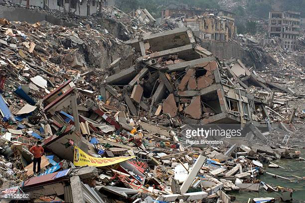 Beichuan quake survivor looks down at his destroyed home in the quake ravaged town where thousands are dead or missing May 16 2008 in Beichuan...