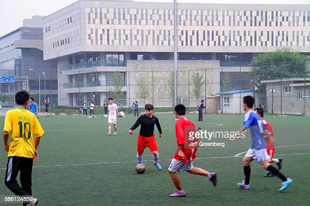 Beidˆ higher education campus Asian man student playing football