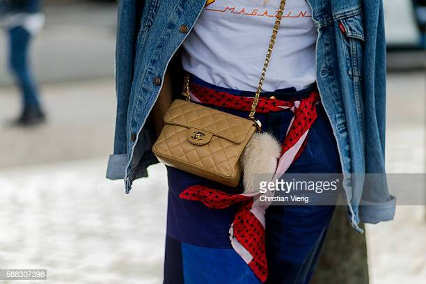 A beige Chanel bag and scarf as a belt outside Freya Dalsjo during the first day of the Copenhagen Fashion Week Spring/Summer 2017 on August 10 2016...