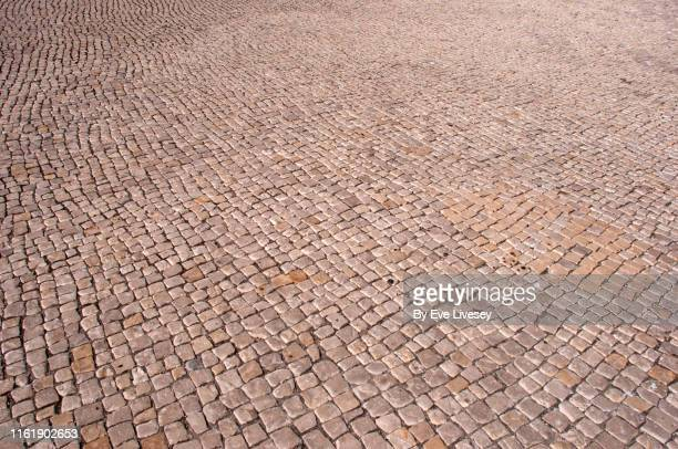 beige cobblestone background - paving stone stock pictures, royalty-free photos & images