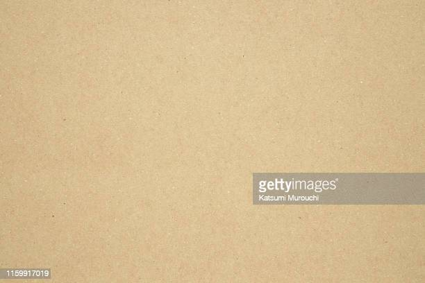 beige craft paper cardboard texture background - vakmanschap stockfoto's en -beelden