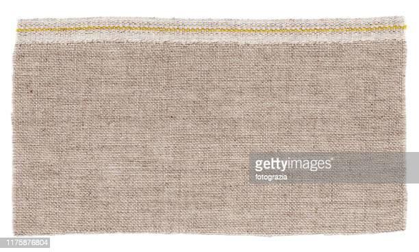 beige fabric isolated on white - 荒い麻布 ストックフォトと画像