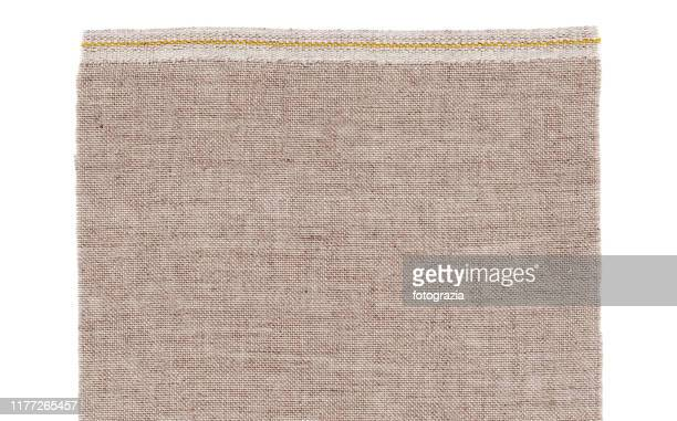 beige fabric isolated on white - sepia stock pictures, royalty-free photos & images