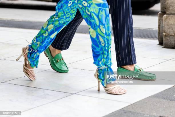 Beige mesh sandals by Bottega Veneta as a detail of influencer Gitta Banko and green shoes with gold details by Gucci as a detail of stylist Bert...