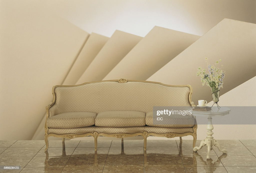 Beige Oldfashioned Sofa With Side Table Stock Photo Getty Images - Old fashioned side table