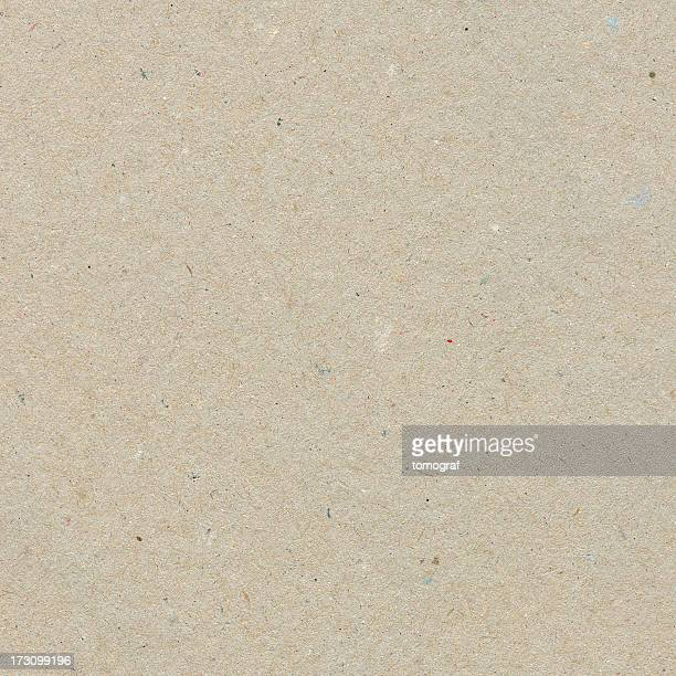 Beige recycled paper with texture grains