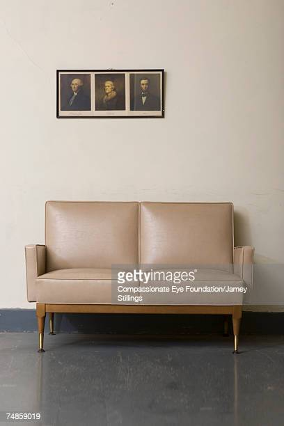 Beige sofa and pictures on wall