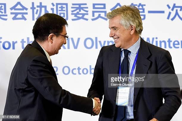 Beijing 2022 Executive Vice-President and Beijing Vice Mayor Zhang Jiandong and IOC Vice President Juan Antonio Samaranch Salisachs shake hands after...