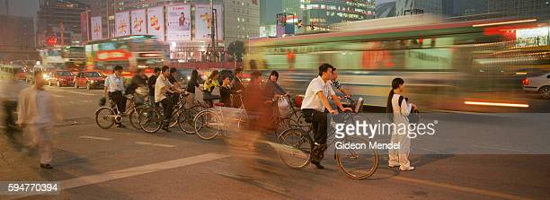 Beijing A City Transforming Cyclists and traffic share the streets in the evening rush hour in the busy Zhongguancun district which is known as the...