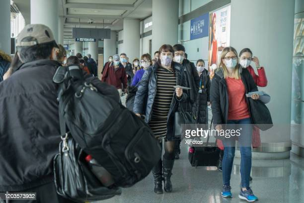 beijing airport during coronavirus outbreak - protective face mask stock pictures, royalty-free photos & images