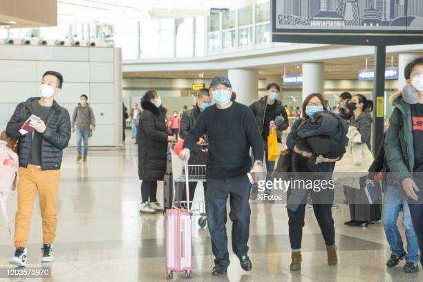beijing airport during coronavirus outbreak - china coronavirus stock pictures, royalty-free photos & images