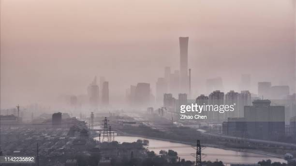 beijing cbd in the haze - beijing smog stock pictures, royalty-free photos & images