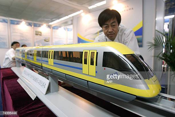A Chinese engineer shows of a locally designed electric train at a hitech expo in Beijing 25 May 2007 Radiation fears have prompted China to shelve a...