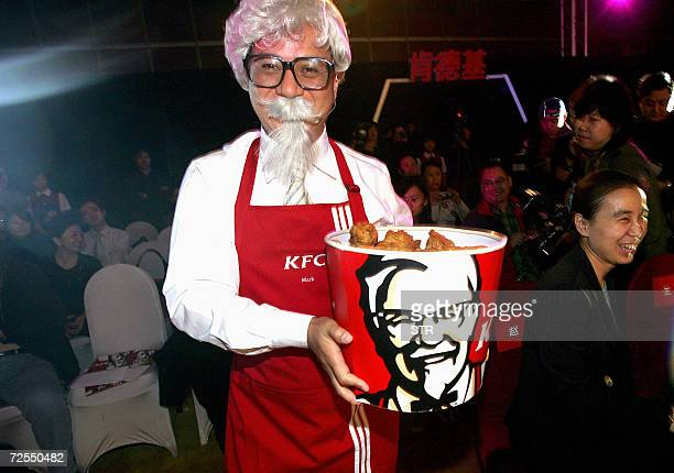 A Chinese promoter dresses up as US fastfood giant Kentucky Fried Chicken's Colonel Sanders during a launch of the company's new logo in Beijing 14...