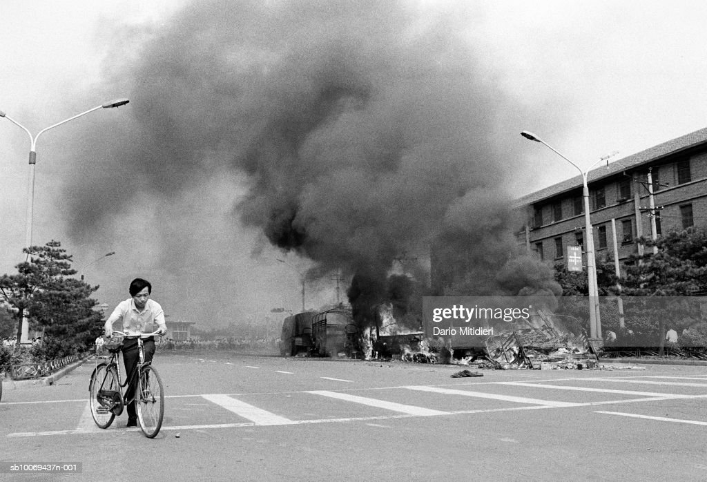 Young man with bicycle at Tiananmen Square (B&W) : News Photo