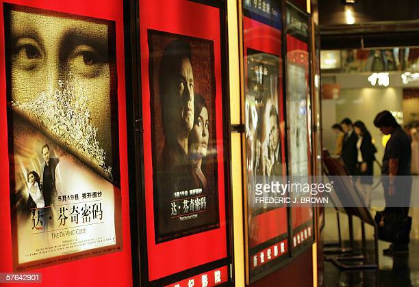 A man reads promotional material for the Hollywood film The Da Vinci Code 18 May 2006 at a movie theater in Beiijng's upscale Oriental Plaza shopping...