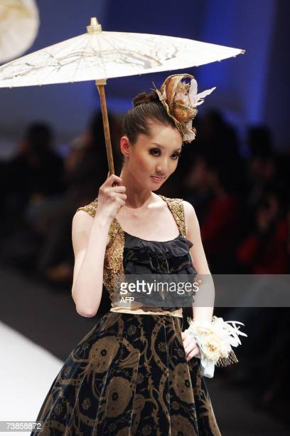 A model parades a fashion design by a young designer during a contest to kick off the 10th China Fashion Week in Beijing 17 March 2007 China is the...