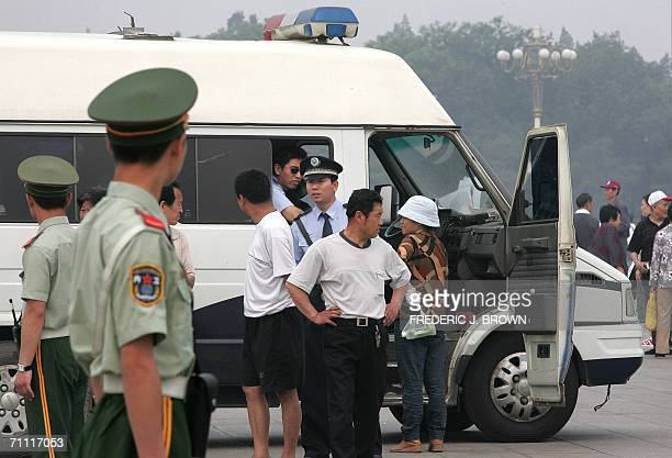 Policeman questions people on Tiananmen Square, 04 June 2006, amid heightened security on the 17th anniversary of the 1989 Tiananmen Square massacre...