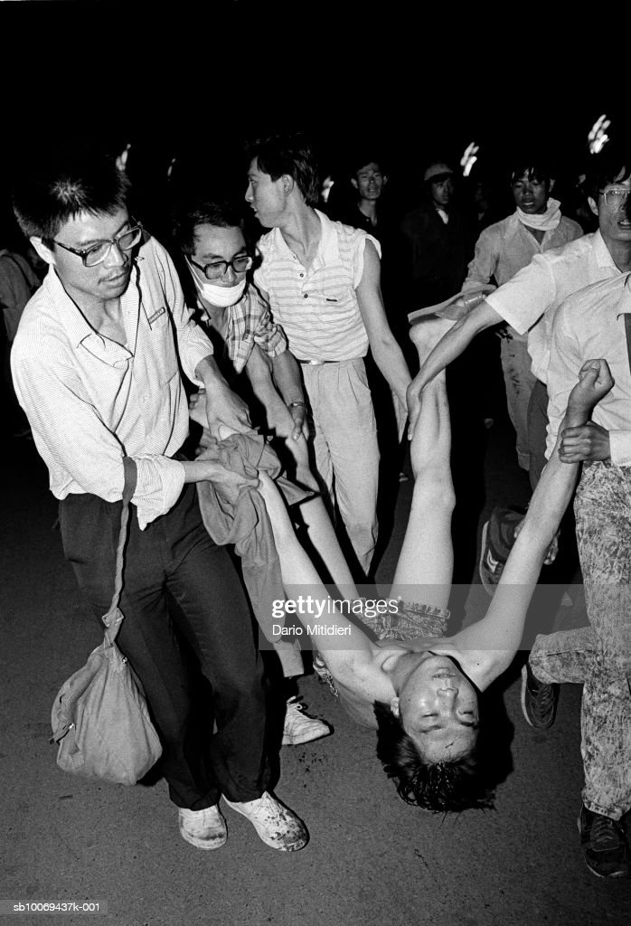 1989, Beijing, China, A pro-democracy student shot by the Chinese army is carried away by protestors during the bloody occupation of Tiananmen Square.,; date created: 2008:05:06; Tiananmen Square Massacre