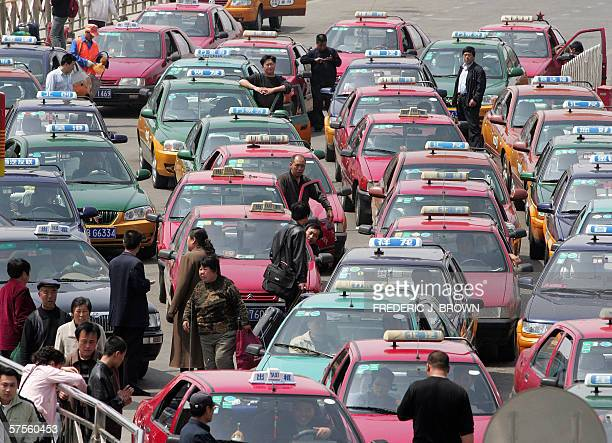 A queue of taxi drivers wait for passengers near the railway station in Beijing 30 April 2006 as thousands travel ahead of the weeklong 01 May Day...