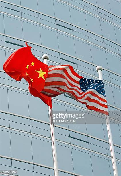 A US and a Chinese flag wave outside a commercial building in Beijing 09 July 2007 US Secretary of State Condoleezza Rice 06 July 2007 accused China...