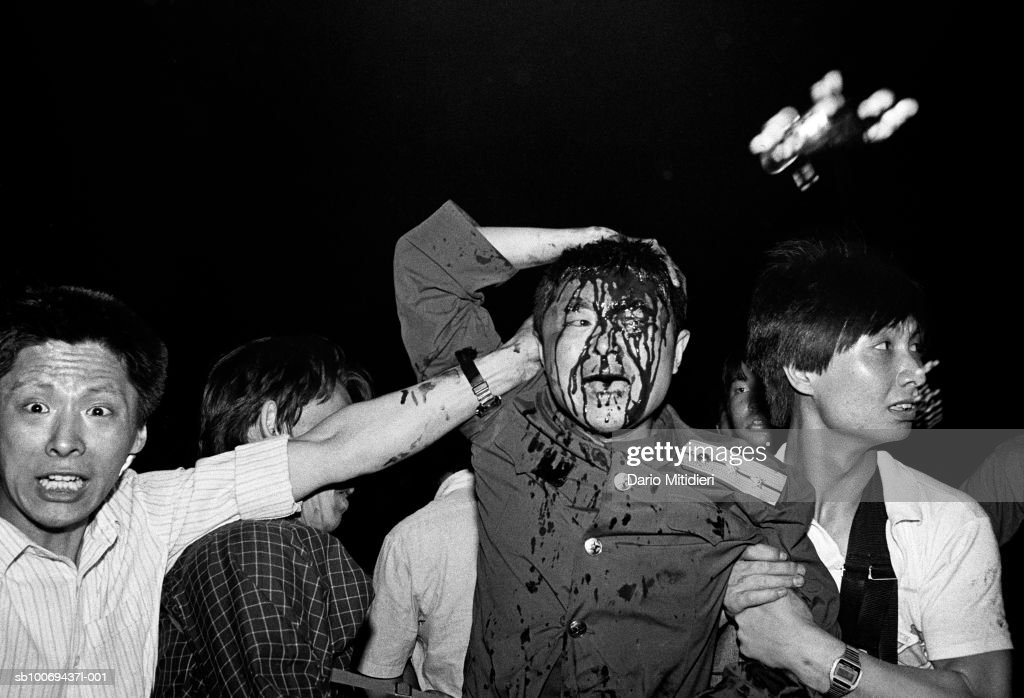 1989, Beijing, China, A wounded soldier of the Chinese army is rescued by students after his tank was destroyed during the Tiananmen Square massacre during the night between the 3rd and the 4th of June, 1989.,; date created: 2008:05:06; Tiananmen Square Massacre