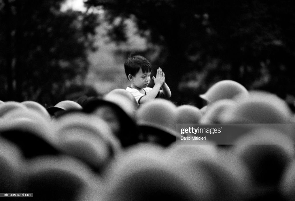 1989, Beijing, China, A young boy welcomes Chinese soldiers approaching Tiananmen Square, just a few hours before the massacre had begun, unaware of the significance of the army occupation of Beijing.,; date created: 2008:05:06; Tiananmen Square Massacre