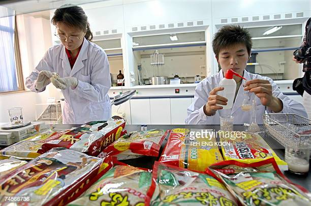 Chinese lab technicians collect food samples at the Beijing administration for industry and commerce center for food safety test in Beijing 12 June...