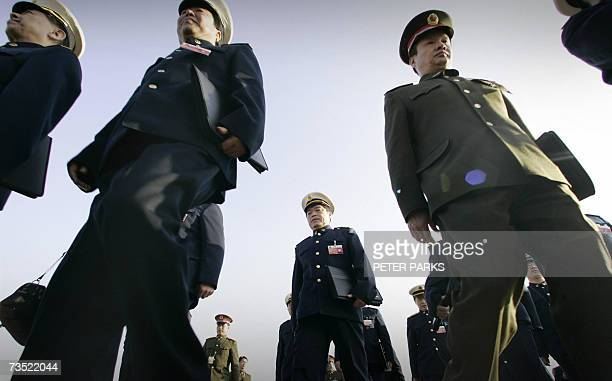 Chinese People's Liberation Army and Navy delegates arrives at the Great Hall of the People in Beijing on the fourth day of the National People's...