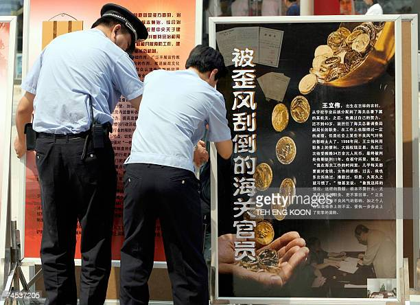 Chinese policemen set up anti corruption billboards on display in Central Beijing 11 June 2007 Unable to stem a rising tide of corruption China is...