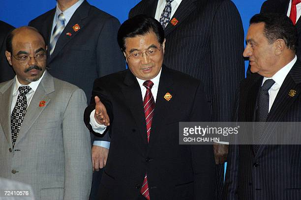 Chinese President Hu Jintao ushers his Egyptian counterpart Hosni Mubarak and Ethiopian Prime Minister Meles Zenawi to announce the new partnership...