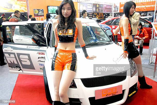 Chinese promoters pose with a soupedup car at a modified cars fair in Beijing 10 April 2007 Passenger car sales in China rose by 161 percent in March...