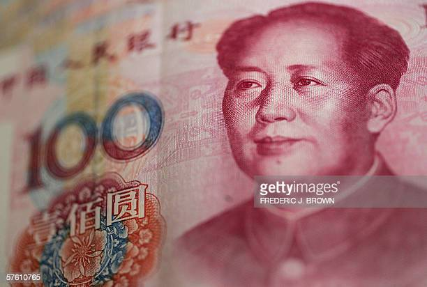 Communist China's founding father Mao Zedong's image is seen on a 100 renminbi note, 15 May 2006, in Beijing. It was forty years ago 16 May 1966 that...